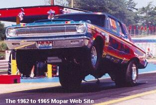 Bob Marshall's DODGE MATERIAL from Ohio. 1965 SS/BA Hemi Dodge Coronet. Photo was taken by Dave McGee at the Mopar Muscle Southern Classic event in 1999. Bob won SS at that event: 9 second early B. Photo courtesy of Roarin65ATaol.com
